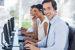 Joyful agent working in a call centre Royalty Free Stock Images