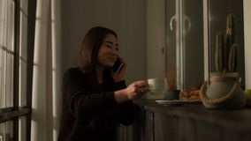 Joyful asian young woman chatting on cellphone stock video footage