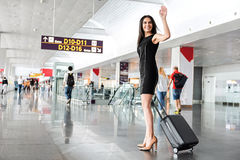 Joyful attractive lady is standing with luggage Stock Photography