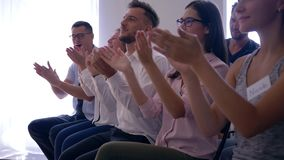 Joyful audience of business people clapping hands on successful training seminar stock video
