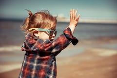 Joyful baby on the beach royalty free stock images