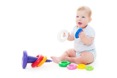 Joyful baby boy. Sitting on floor and playing with toys. isolated on white background Stock Image