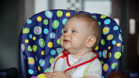 Joyful baby boy at lunch time stock footage