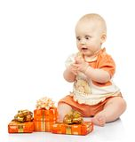 Joyful baby with gifts Royalty Free Stock Image