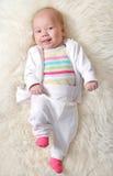 Joyful baby (girl 1,5 months ). Baby girl 1,5 months Royalty Free Stock Photos