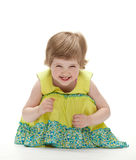 Joyful baby sitting on the floor Royalty Free Stock Photos