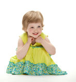 Joyful baby sitting on the floor Stock Photo