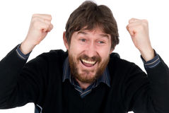 The joyful bearded man with hands fisted Stock Images