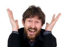 The joyful bearded man with lifted hands Royalty Free Stock Photos