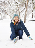 Joyful beautiful girl plays with snow and has fun in winter Stock Photography