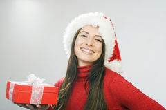 Joyful beautiful woman with a Christmas present Royalty Free Stock Photography