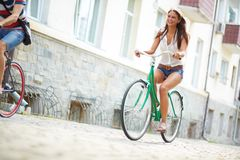 Joyful bicyclist. Portrait of happy young bicyclist riding in park royalty free stock photo