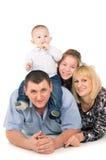Joyful big family posing. Isolated on white background Stock Photos