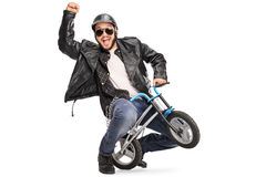 Joyful biker riding a small childish bicycle Stock Photography