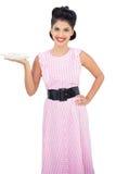 Joyful black hair model holding a plate of candies Stock Photo