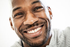 Joyful Black Man. Close up portrait of a happy black man in his 20s isolated on a white background Stock Photography