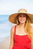 Joyful blonde Woman in Red Dress on the Beach Stock Images