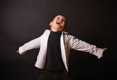 Joyful Boy on a Black Background Royalty Free Stock Photo