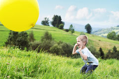 Joyful boy bouncing a balloon Royalty Free Stock Photography