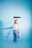 Joyful boy with cleaning swab over blue Stock Photos
