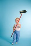 Joyful boy with cleaning swab over blue Stock Photo