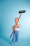 Joyful boy with cleaning swab over blue Stock Photo
