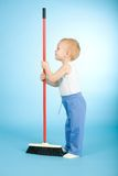 Joyful boy with cleaning swab over blue Royalty Free Stock Photos