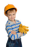 Joyful boy in the construction helmet Stock Photography