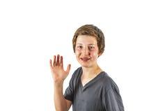 Joyful boy gives sign Royalty Free Stock Images