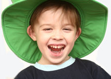 The joyful boy in a green hat Royalty Free Stock Photography