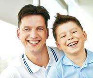 Joyful boy and his father Stock Photo