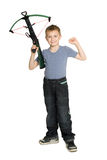 Joyful boy holding a crossbow Royalty Free Stock Image