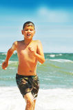 Joyful boy on an ocean coast Royalty Free Stock Photos