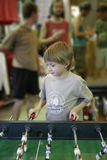 Joyful boy plays table football Royalty Free Stock Photo
