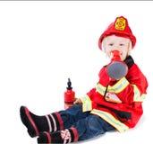 Joyful boy in a suit of fire Stock Photo