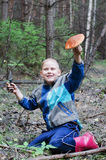 The joyful boy in wood holds in a hand  the big aspen mushroom Royalty Free Stock Photo