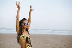 Joyful brazilian woman in fashion bikini at the beach Stock Image