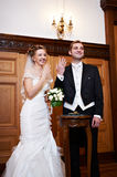 Joyful Bride And Groom At Solemn Registration Royalty Free Stock Photography