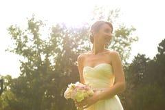 Joyful bride with bouquet Stock Photos