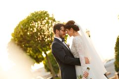 Joyful bride and groom with bouquet Royalty Free Stock Photos