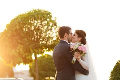 Joyful bride and groom with bouquet Stock Photo