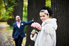 Joyful bride and groom in park Stock Photo