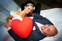 Joyful bride and groom with red heart Royalty Free Stock Photos