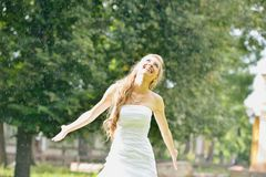 Joyful bride in the rain Stock Photos