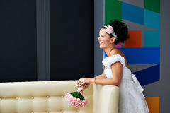 Joyful bride with a wedding bouquet Stock Photos