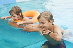 Cheerful brothers in swimming pool stock photos
