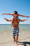 Joyful brothers having fun at the beach Royalty Free Stock Photography