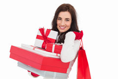 Joyful brunette holding christmas gifts and shopping bags Royalty Free Stock Photo
