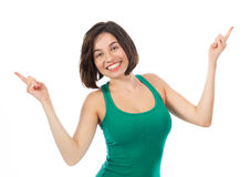 Joyful brunette pointing up Stock Photo