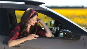 Joyful brunette woman on car summer roadtrip stock footage